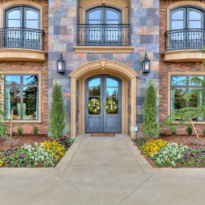 Landscaping design around entrance of million dollar home