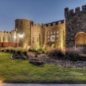OKC castle home nelson landscaping lighting side view