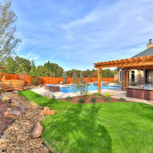 backyard inground pool & dry bed landscaping