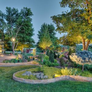 Edmond Oklahoma night time residential lighted landscaping