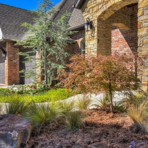 residential landscaping trees and bushes planted by Nelson Landscaping services in Oklahoma