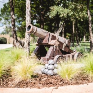 residential landscaping with old fashion canon