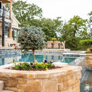 Poolside raised flowerbed McCaleb Homes Cascade Street of Dreams Home by Nelson Landscaping