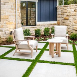 Prayer garden seating area with concrete slabs and turf