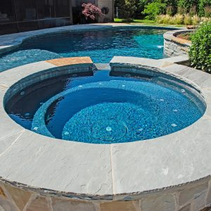 jetted pool by Nelson Landscaping