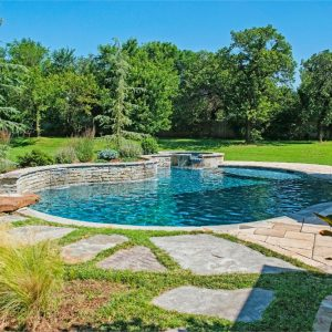 Custom stone inground pool and hot tub