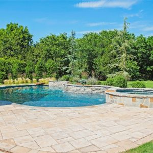 Private inground pool with landscaping