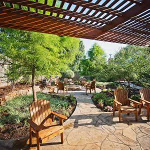 Outdoor Oasis with Pergola and stamped concrete pathways