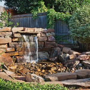 Backyard Water Feature and hardscaping oasis