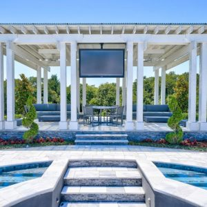 Pool Landscaping with White Pergola designed for retired NFL IL Curtis Lofton