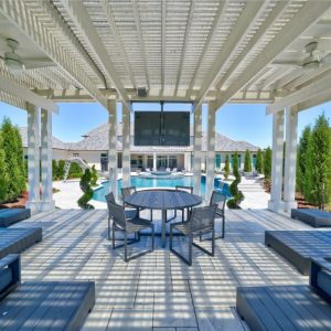 White pergola designed by Nelson Landscaping for retired NFL IL Curtis Lofton