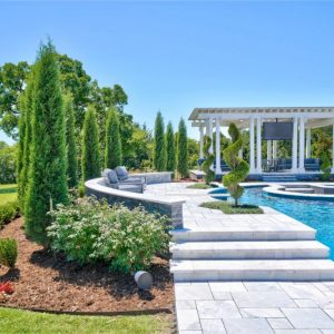 Beautiful paved sidewalk and Pool Landscaping