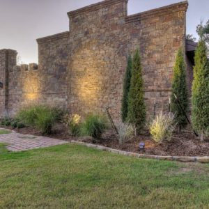 Dusk time Landscape Lighting on Oklahoma castle house wall lighting