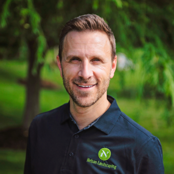Chad from Nelson Landscaping with serveral trees in lush green setting