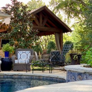 Backyard Pavilion with Seating area next to Pool designed for Jeff Roberts from KMGL Magic 104.1 radio