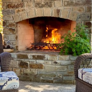 Custom outdoor fireplace with plants designed for Jeff Roberts from KMGL Magic 104.1 radio
