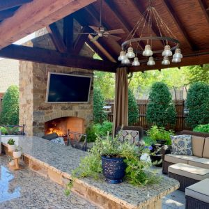Outdoor fireplace, grill, TV, Lighting with seating