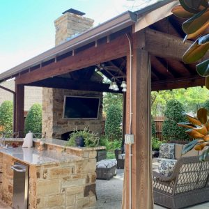 Custom Pavilion and Outdoor Fireplace with grill by Nelson Landscaping