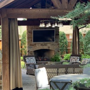 Outdoor bar and fireplace with lighting for guests