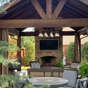 Custom Pavilion and Outdoor Fireplace with wet bar and lighting
