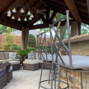Bar stool seating next to Nelson Landscaping backyard pavilion for The Magic Man Jeff Roberts