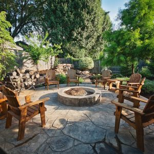 Backyard patio with firepit by Nelson Landscaping