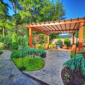 custom pergola and stone walkway