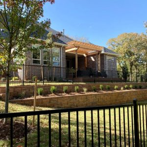 Metal fencing around landscaping and retaining wall project