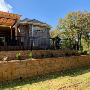 Looking up at retaining wall landscaping project by Nelson Landscaping