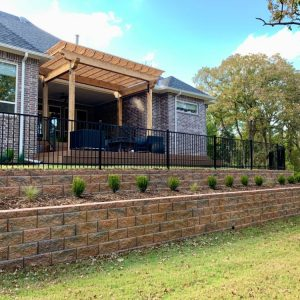 Nelson Landscaping custom designed stone retaining wall and deck