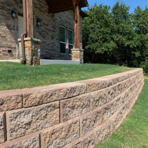 Retaining wall project creating easy access to brick home