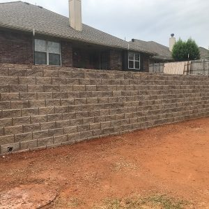 retaining wall is a structure that stabilizes and holds soil in place