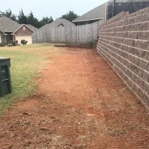 retaining wall is a structure that stabilizes and holds Oklahoma soil in place