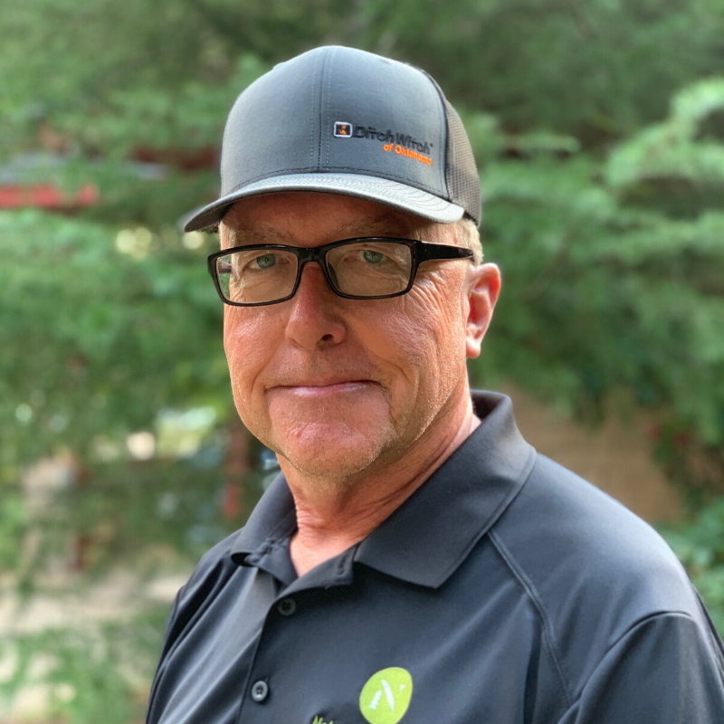 Scot from Nelson Landscaping wearing company polo shirt and ball cap.