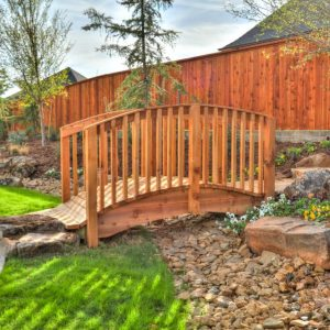 Backyard Dry Creek Riverbed with Custom-Built Bridge & Landscaping