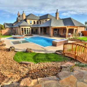 classic home design landscaping backyard Dry Creek Riverbed with Custom-Built Bridge & Landscaping