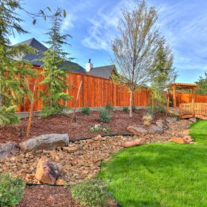 Backyard Dry Creek Riverbed & Landscaping design by Nelson Landscaping