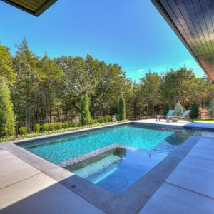 Backyard Pool Landscaping with modern Street of Dreams Matteson Homes